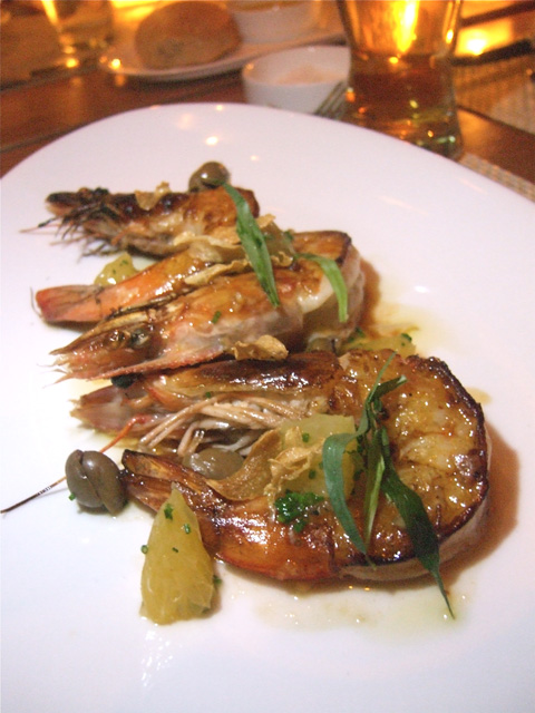 Prawns off the plancha get a lift from olives and  toasted garlic. Photo: Steven Richter