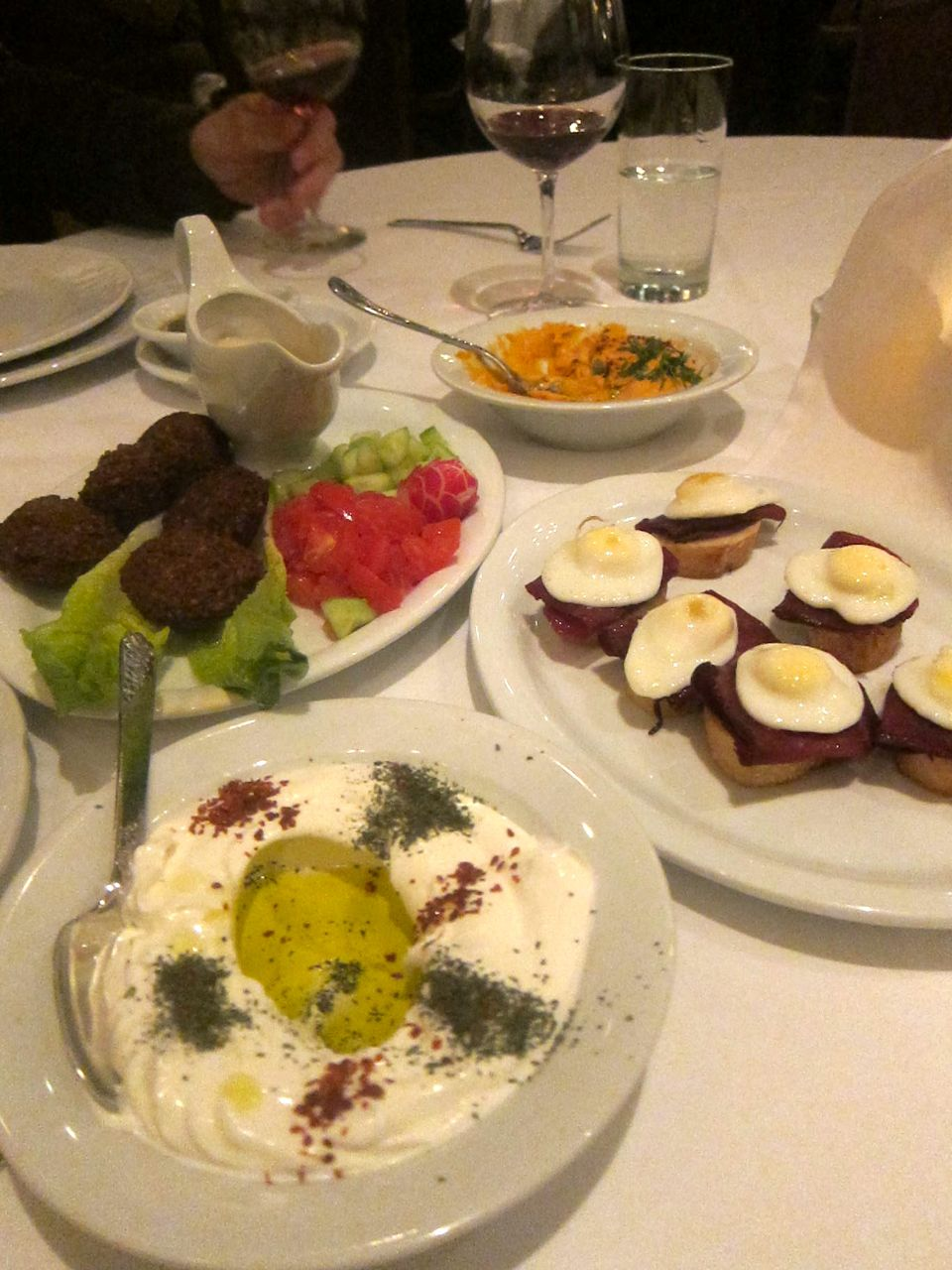 From top: Hummus Almayass, basterma with quail egg, labneh and falafel. 
