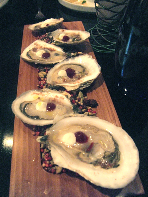 Duxbury oysters with pomegranate dust and gel upstairs at Anthos. Photo: Steven Richter
