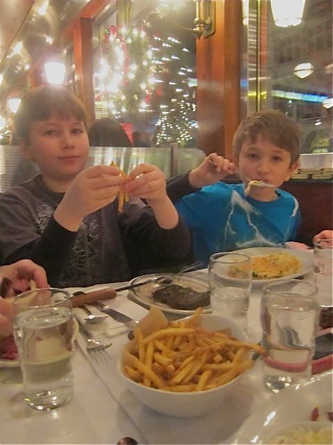 The boys split a $26 dish at Brooklyn Dinrer. Jonah gets steak; pasta makes Aiden happy.