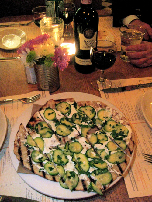 Zucchini cushioned on truffled robbiolo makes a fine grilled pizza.  Photo: Steven Richter