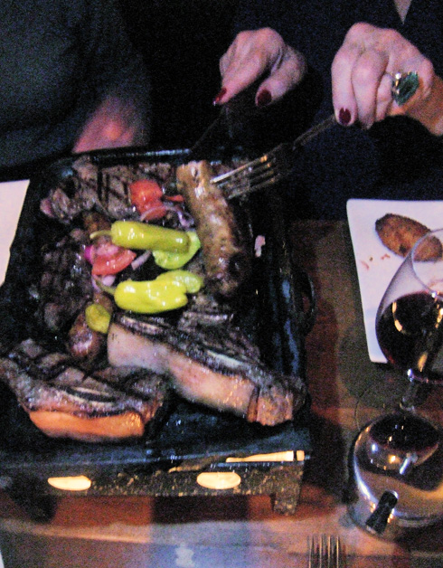 Sausages, steak and ribs from the Argentine grill for two. Photo: Steven Richter