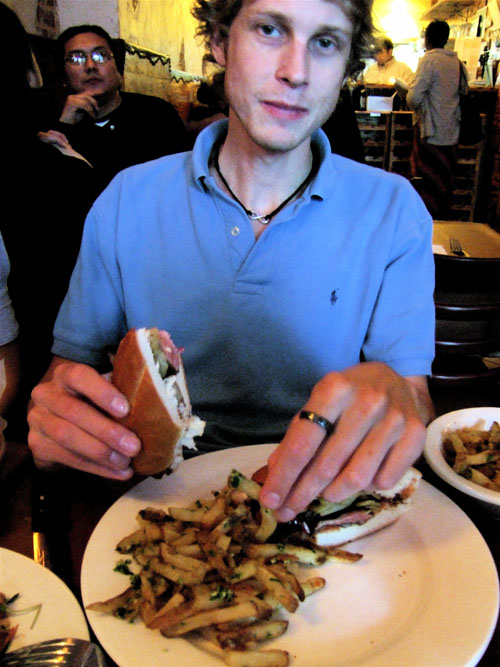 The worldly scion savors his rib eye sandwich.                                          Photo: Steven Richter