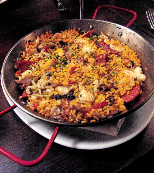 Juicy rabbit is a rarity in Pamplon's fine paella. Photo: Steven Richter