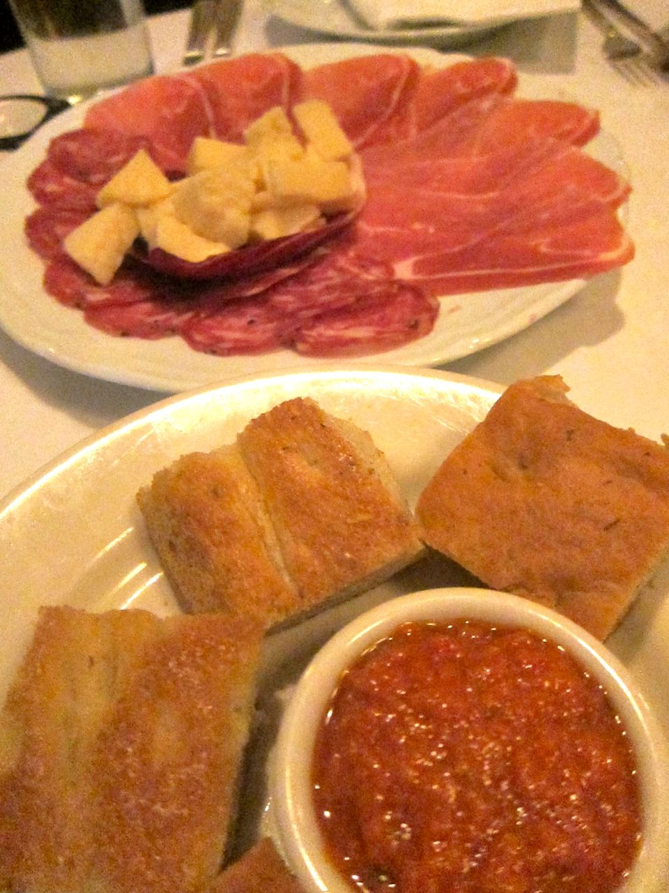 I'm filling up on Primola's freebies: addictive breadsticks, salumi, focaccia…