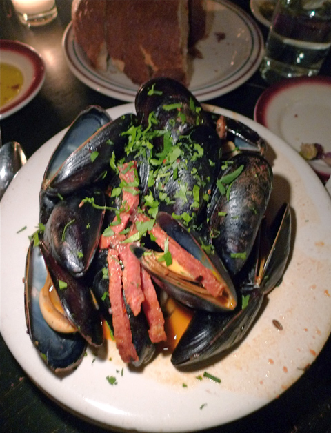 Plump wild mussels with spicy salami in a fragrant, garlicky broth.                                   Photo: Steven Richter