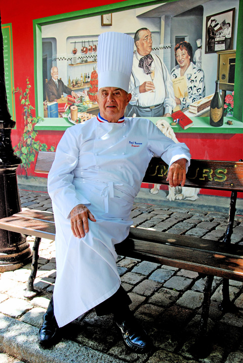 Paul Bocuse strikes a pose on his Rue des Grand Chefs in the courtyard. Photo:Steven Richter
