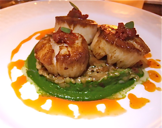 The kitchen honors the sweet voluptuousness of great scallops.  Photo: Steven Richter
