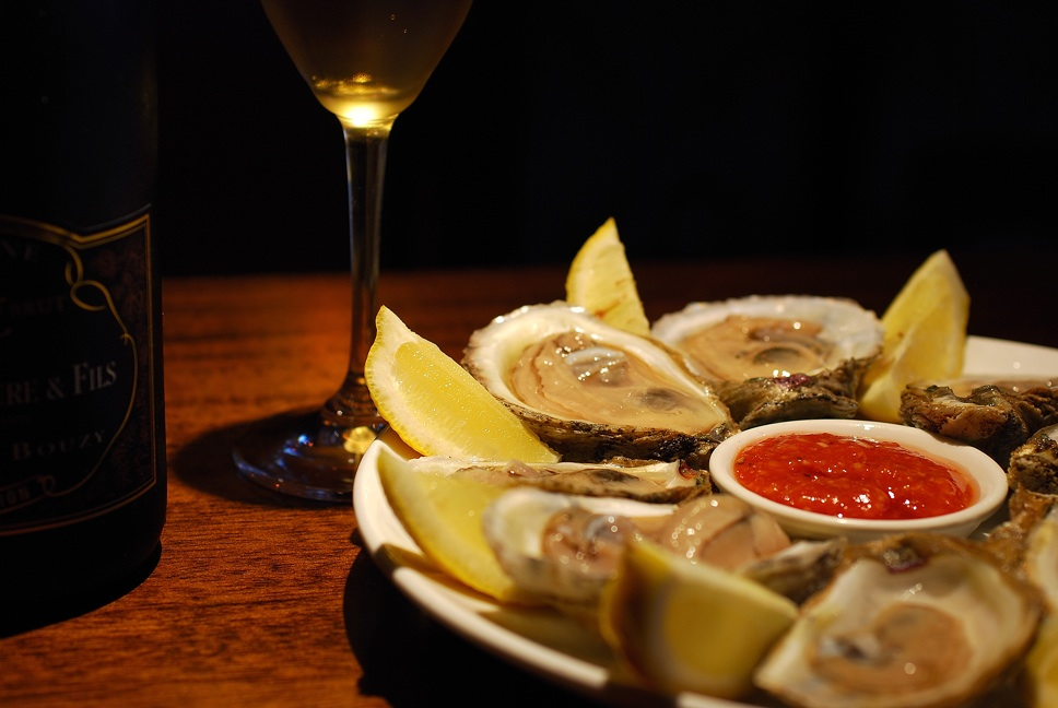 Slurp happy hour dollar oysters at Lelabar to your heart's content - or until they run out. Photo: Itzik Serussi