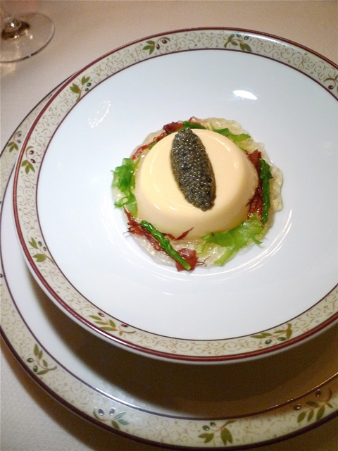 Sea urchin pana cotta crowned with caviar sits on sea consommé. Photo: Steven Richter