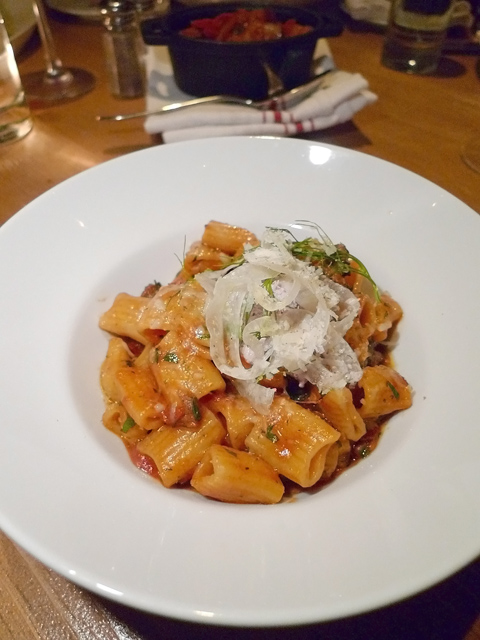 Fennel strings crown rigatoni with merguez sausage and goat cheese. Photo: Steven Richter