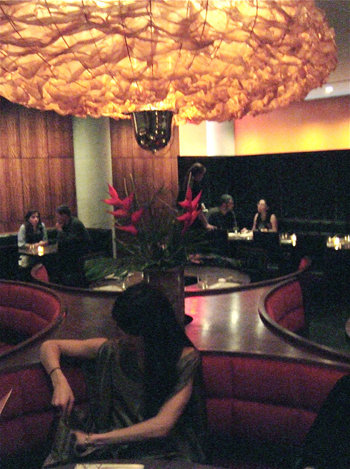 Wrinkled parachutes cast a rosy glow on circle booths at Shang. Photo: Steven Richter