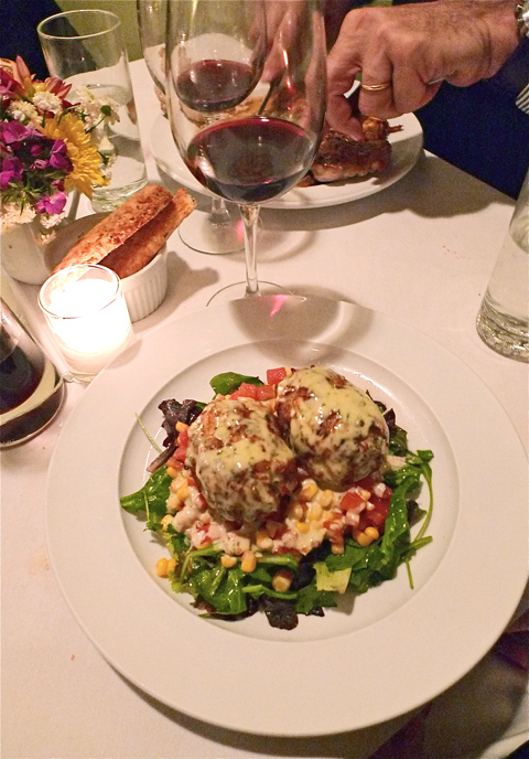 Jumbo lump crab cakes are so good, I forgive the saucey excess. Photo: Steven Richter