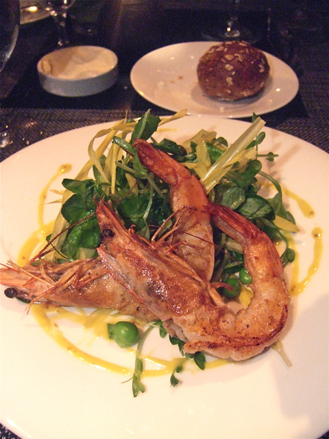Crusty giant shrimp on salad with peas, peashots and pistachio has welcome pizazz. Photo: Steven Richter