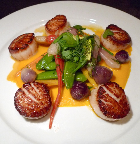Chef Amitzur Mor's perfectly cooked scallops with market veggies. Photo: Steven Richter